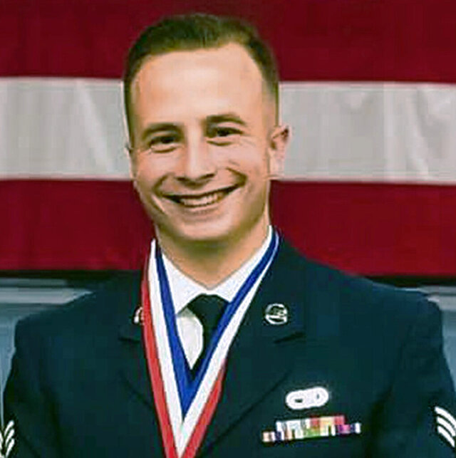This February 2019 photo provided by the Westover Air Reserve Base shows U.S. Air Force Staff Sgt. Ronald Ouellette, 23, of Merrimack, N.H., at the air base in Chicopee, Mass. Ouellette died Monday, Sept. 14, 2020, from non-combat injuries suffered in an ATV accident while deployed in Kuwait. (Courtesy of Westover Air Reserve Base via AP)