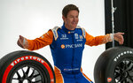 IndyCar driver Scott Dixon poses for photos during IndyCar auto racing media day, Monday, Feb. 11, 2019, in Austin, Texas. (AP Photo/Stephen Spillman)