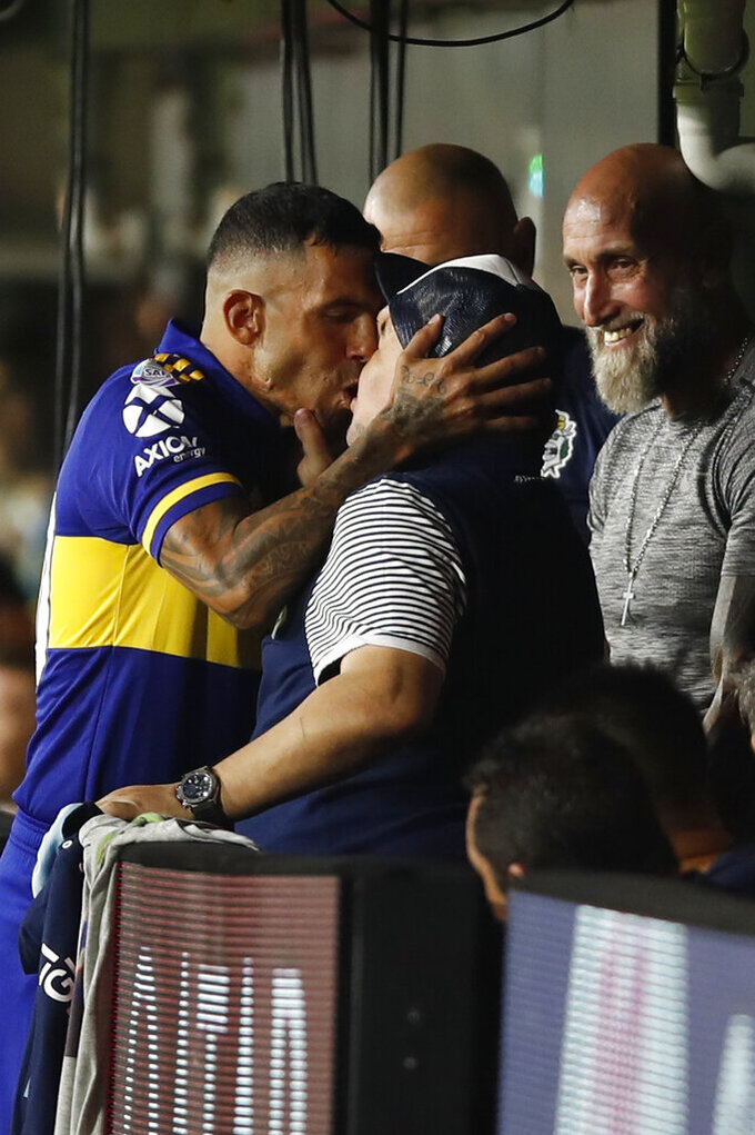 Boca Juniors' Carlos Tevez kisses Gimnasia y Esgrima 's coach Diego Maradona prior to an Argentina's soccer league match at La Bombonera stadium in Buenos Aires, Argentina, Saturday, March 7, 2020. (AP Photo/Natacha Pisarenko)