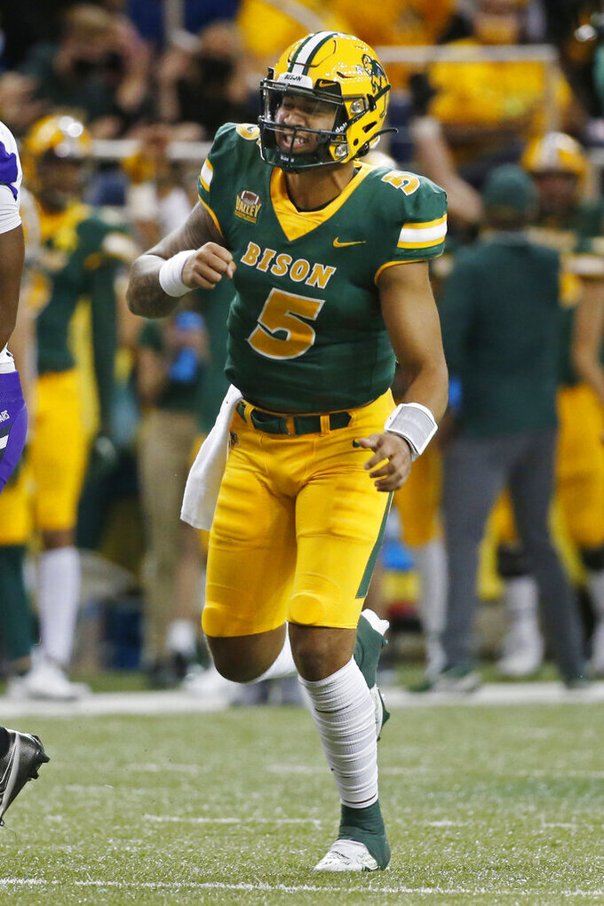 North Dakota State quarterback Trey Lance celebrates his touchdown pass against Central Arkansas in the second quarter of an NCAA college football game Saturday, Oct. 3, 2020, in Fargo, N.D. (AP Photo/Bruce Kluckhohn)