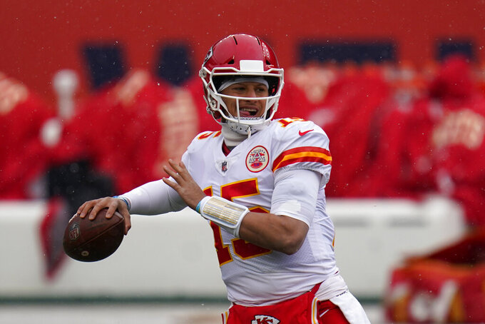Kansas City Chiefs quarterback Patrick Mahomes warms up before an NFL football game against the Denver Broncos, Sunday, Oct. 25, 2020, in Denver. (AP Photo/Jack Dempsey)