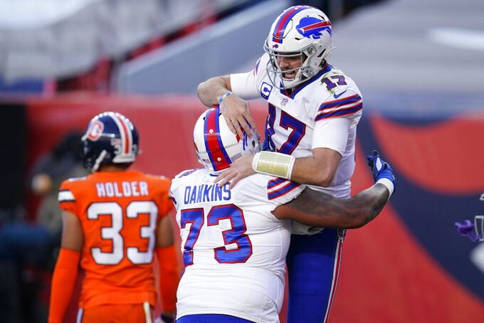 Buffalo Bills quarterback Josh Allen, above, celebrates with teammate offensive tackle Dion Dawkins after scoring a touchdown during the first half of an NFL football game against the Denver Broncos, Saturday, Dec. 19, 2020, in Denver. (AP Photo/David Zalubowski)
