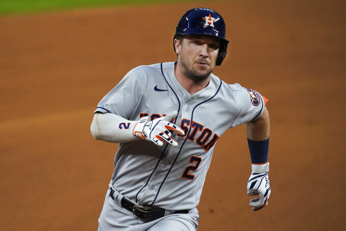 Houston Astros' Alex Bregman heads to third with a triple during the first inning of the team's baseball game against the Texas Rangers in Arlington, Texas, Thursday, Sept. 24, 2020. (AP Photo/Tony Gutierrez)