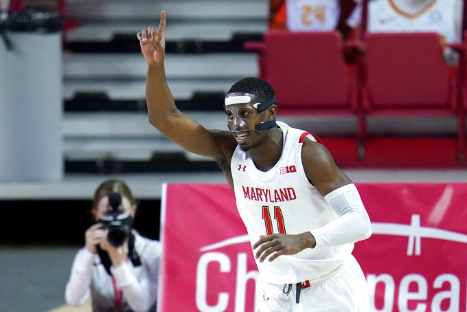 Maryland guard Darryl Morsell reacts after scoring a basket against Purdue during the first half of an NCAA college basketball game, Tuesday, Feb. 2, 2021, in College Park. (AP Photo/Julio Cortez)