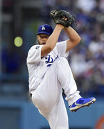 Los Angeles Dodgers pitcher Clayton Kershaw winds up during the first inning of the team's baseball game against the Philadelphia Phillies on Saturday, June 1, 2019, in Los Angeles. (AP Photo/Mark J. Terrill)