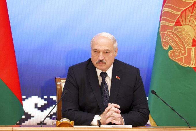 Belarus President Alexander Lukashenko speaks during a meeting with officials in Minsk, Belarus, Friday, July 23, 2021. (Sergei Shelega/BelTA Pool Photo via AP)