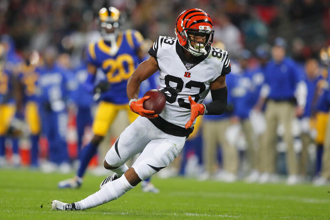 Cincinnati Bengals wide receiver Tyler Boyd (83) slips on the field while running against the Los Angeles Rams during the second half of an NFL football game, Sunday, Oct. 27, 2019, at Wembley Stadium in London. (AP Photo/Frank Augstein)