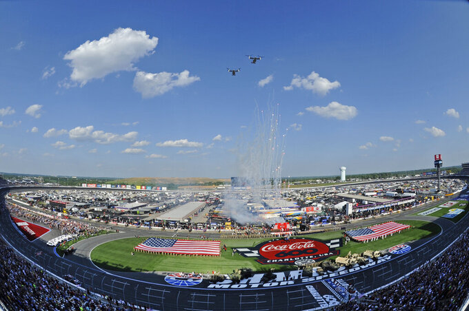 Marine V-22 Ospreys perform a flyover during activities before a NASCAR Cup Series auto race at Charlotte Motor Speedway in Concord, N.C., Sunday, May 26, 2019. (AP Photo/Mike McCarn)