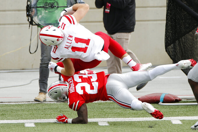 Ohio State defensive back Marcus Hooker, bottom, tackles Nebraska tight end Austin Allen during the first half of an NCAA college football game Saturday, Oct. 24, 2020, in Columbus, Ohio. (AP Photo/Jay LaPrete)