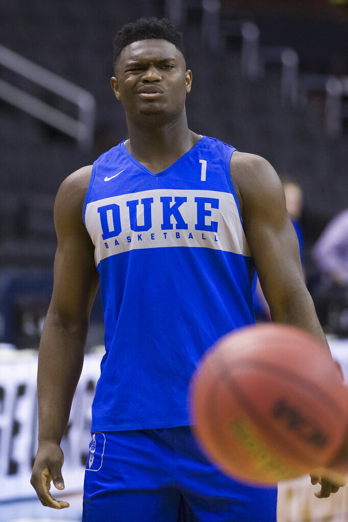 Duke forward Zion Williamson reacts during an NCAA men's college basketball practice in Washington, Thursday, March 28, 2019. Duke plays Virginia Tech in an East Regional semifinal game on Friday. (AP Photo/Alex Brandon)