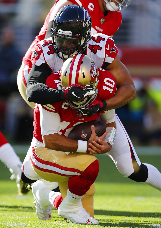 Atlanta Falcons defensive end Vic Beasley (44) sacks San Francisco 49ers quarterback Jimmy Garoppolo (10) during the first half of an NFL football game in Santa Clara, Calif., Sunday, Dec. 15, 2019. (AP Photo/John Hefti)