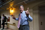 Sen. Joe Manchin, D-W.Va., a key infrastructure negotiator, signals to his staff as he works behind closed doors with other Democrats in a basement room at the Capitol in Washington, Wednesday, June 16, 2021. (AP Photo/J. Scott Applewhite)