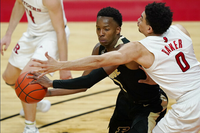 Rutgers' Geo Baker, right, defends against Purdue guard Eric Hunter Jr. (2) as Hunter looks to pass during the first half of an NCAA college basketball game Tuesday, Dec. 29, 2020, in Piscataway, NJ. (AP Photo/Kathy Willens)