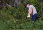 Justin Thomas hits out of the rough on the fourth fairway during the second round of the Tournament of Champions golf event Friday, Jan. 4, 2019, at Kapalua Plantation Course in Kapalua, Hawaii. (AP Photo/Matt York)