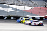 Ryan Blaney, left, and Denny Hamlin, right, do battle as they come out of Turn 4 during a NASCAR Cup Series auto race at Texas Motor Speedway in Fort Worth, Texas, Sunday, July 19, 2020. (AP Photo/Ray Carlin)