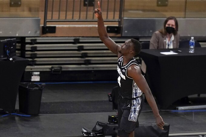 Georgetown's Chudier Bile (4) gestures after making a three point basket during the second half of an NCAA college basketball game against Creighton in the championship of the Big East Conference tournament Saturday, March 13, 2021, in New York. (AP Photo/Frank Franklin II)