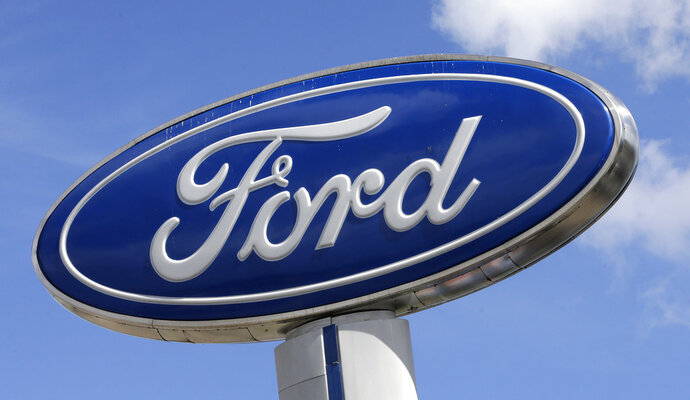 FILE - This Jan. 17, 2017, file photo shows a Ford sign at an auto dealership, in Hialeah, Fla. There's no apparent signs that Wall Street is worried about a plant fire that is forcing Ford to cut back on production of its F-150 pickup, the top-selling vehicle in America. The company suspended F-150 and Super Duty production in several cities. (AP Photo/Alan Diaz, File)