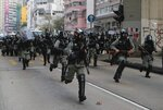 Police arrive to chase away protestors in Hong Kong, Sunday, Oct. 20, 2019. Hong Kong protesters again flooded streets on Sunday, ignoring a police ban on the rally and setting up barricades amid tear gas and firebombs. (AP Photo/Kin Cheung)