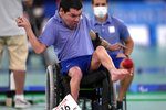 Argentina's Mauricio Ibarbure competes against Japan's Takumi Nakamura in the boccia individual BC1 pool match at the Tokyo 2020 Paralympic Games, Saturday, Aug. 28, 2021, in Tokyo, Japan. Each athlete has unique differences that have to be classified according to individual impairments. (AP Photo/Shuji Kajiyama)