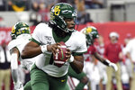 FILE - In this Dec. 7, 2019, file photo, Baylor quarterback Gerry Bohanon (11) rolls out to pass against Oklahoma during the first half of an NCAA college football game for the Big 12 Conference championship in Arlington, Texas. Bohanon is getting his chance as Baylor's starting quarterback after 3 and half seasons on campus. He starts when the Bears open their season Saturday night at Texas State.  (AP Photo/Jeffrey McWhorter, File)