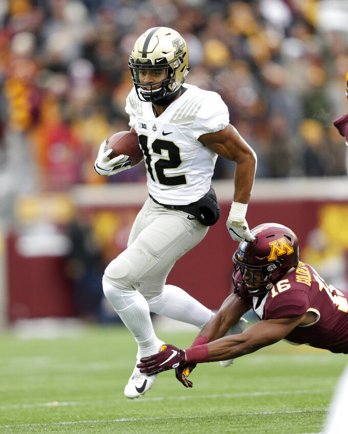Purdue running back Jared Sparks (12) runs past Minnesota defensive back Condey Durr in the first quarter of an NCAA college football game Saturday, Nov. 10, 2018, in Minneapolis. (AP Photo/Andy Clayton-King)