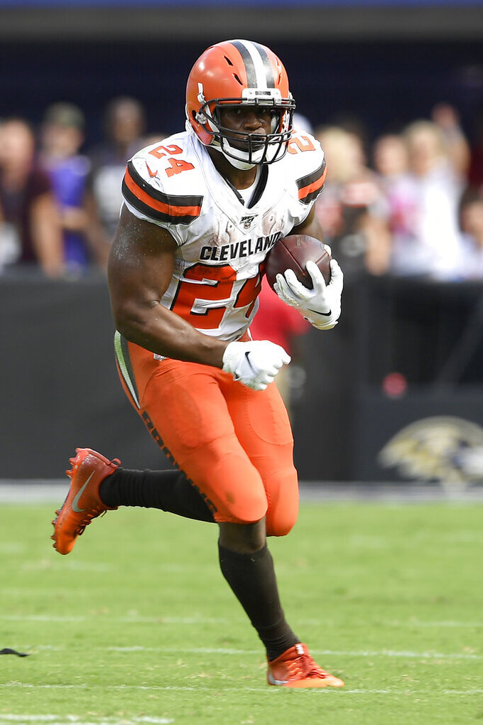 Cleveland Browns running back Nick Chubb runs with the ball against the Baltimore Ravens during the first half of an NFL football game Sunday, Sept. 29, 2019, in Baltimore. (AP Photo/Nick Wass)