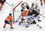 Edmonton Oilers scramble in front of the Chicago Blackhawks net during the third period of an NHL hockey playoff game in Edmonton, Alberta, Saturday, Aug. 1, 2020. (Jason Franson/The Canadian Press via AP)