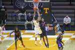 Tennessee guard Yves Pons (35) shoots against Florida forward Omar Payne (5) during an NCAA college basketball game Sunday, March 7, 2021, in Knoxville, Tenn. (Randy Sartin/Pool Photo via AP)