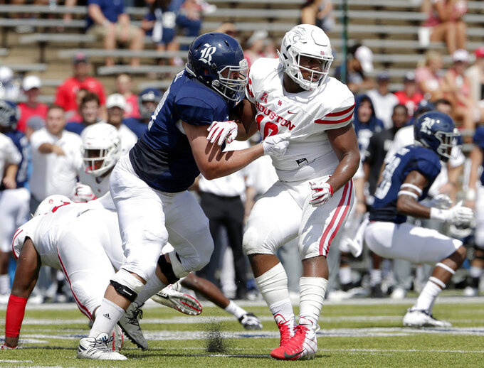 Rice offensive lineman Joseph Dill (79) holds back Houston defensive tackle Ed Oliver (10) during the first half of a NCAA college football game Saturday, Sep. 1, 2018, in Houston. (AP Photo/Michael Wyke)