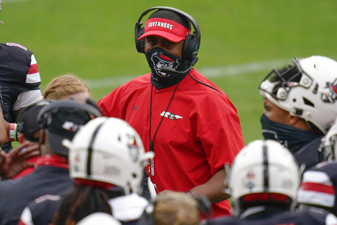 Austin Peay coach Marquase Lovings talks with his team during the first half of an NCAA college football game against Pittsburgh, Saturday, Sept. 12, 2020, in Pittsburgh. (AP Photo/Keith Srakocic)