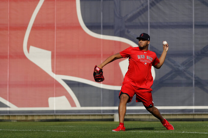 Boston Red Sox relief pitcher Darwinzon Hernandez (63) throws after reporting for spring training baseball Tuesday, Feb. 11, 2020, in Fort Myers, Fla. (AP Photo/John Bazemore)