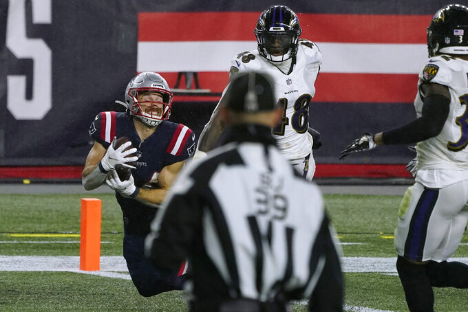 New England Patriots running back Rex Burkhead, left, catches a touchdown pass thrown by wide receiver Jakobi Meyers in the first half of an NFL football game against the Baltimore Ravens, Sunday, Nov. 15, 2020, in Foxborough, Mass. (AP Photo/Charles Krupa)