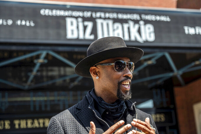 """Montell Jordan speaks to members of the media as he arrives for the funeral of Marcel Theo Hall, aka """"Biz Markie"""", outside the Patchogue Theater for the Performing Arts on Monday Aug. 2, 2021 in Patchogue, NY. (Alejandra Villa Loarca/Newsday via AP)"""