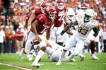 FILE - In this Oct. 6, 2018, file photo, Oklahoma quarterback Kyler Murray (1) scrambles against Texas during the first half of an NCAA college football game at the Cotton Bowl in Dallas. The Sooners face Texas in the Big 12 championship game on Saturday. (AP Photo/Cooper Neill, FIle)