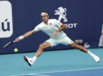 Roger Federer, of Switzerland, returns to Radu Albot, of Moldova, during the Miami Open tennis tournament, Saturday, March 23, 2019, in Miami Gardens, Fla. (AP Photo/Lynne Sladky)