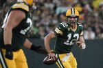 Green Bay Packers' Aaron Rodgers scrambles during the second half of an NFL football game against the Detroit Lions Monday, Sept. 20, 2021, in Green Bay, Wis. (AP Photo/Morry Gash)