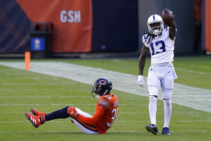 Indianapolis Colts' T.Y. Hilton (13) reacts after making a catch against Chicago Bears' Eddie Jackson (39) during the first half of an NFL football game, Sunday, Oct. 4, 2020, in Chicago. (AP Photo/Nam Y. Huh)