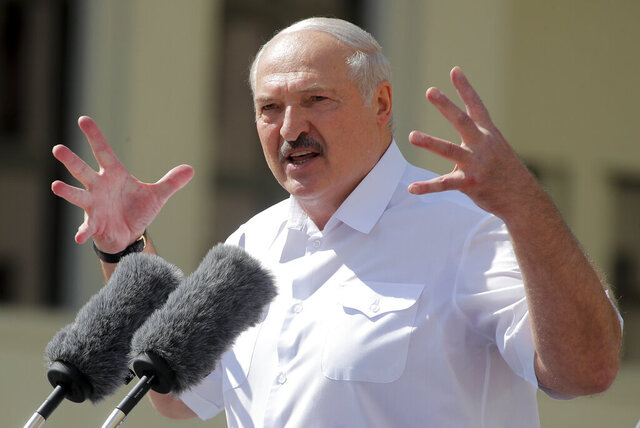 Belarusian President Alexander Lukashenko addresses his supporters gathered at Independent Square of Minsk, Belarus, Sunday, Aug. 16, 2020. Thousands of people have gathered in a square near Belarus' main government building for a rally to support President Alexander Lukashenko, while opposition supporters whose protests have convulsed the country for a week aim to hold a major march in the capital. (AP Photo/Dmitri Lovetsky)