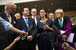 British lawmaker Layla Moran, second right, along with a cross-party delegation of British parliamentarians talk to journalists after meeting European Union chief Brexit negotiator Michel Barnier at the European Commission headquarters in Brussels, Friday, July 19, 2019. (AP Photo/Francisco Seco)