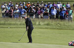 Rory McIlroy, of Northern Ireland, chips onto the seventh green during a practice round for the U.S. Open Golf Championship, Tuesday, June 12, 2018, in Southampton, N.Y. (AP Photo/Julie Jacobson)