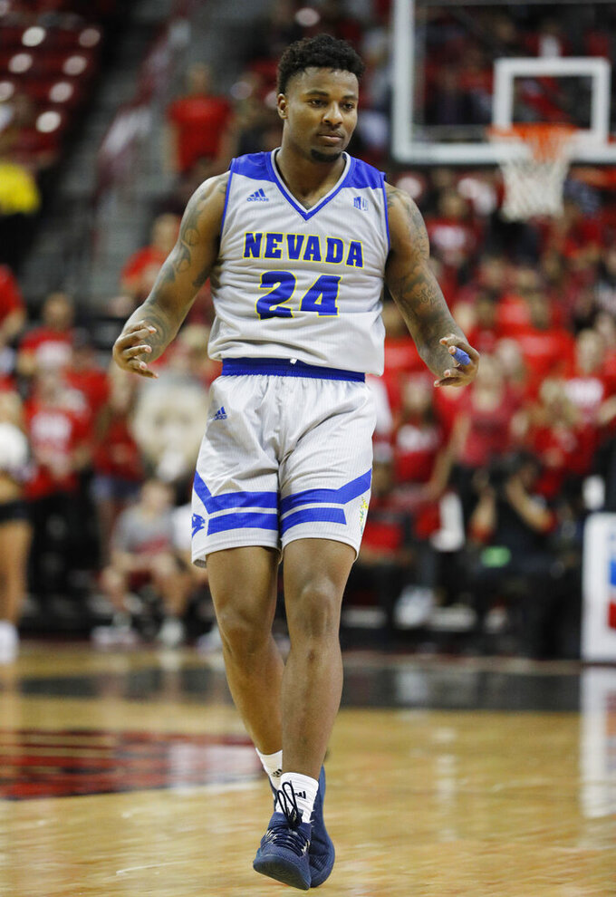 Nevada's Jordan Caroline reacts after making a 3-point shot against UNLV during the second half of an NCAA college basketball game Tuesday, Jan. 29, 2019, in Las Vegas. Nevada won 87-70. (AP Photo/John Locher)