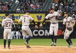 The Houston Astros celebrate a 6-2 win against the Chicago White Sox in the first baseball game of a doubleheader Tuesday, Aug. 13, 2019, in Chicago. (AP Photo/David Banks)