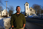 In this Tuesday, March 12, 2019 photo, former SWAT officer Al Joyce walks in Norway, Maine. Joyce left his job in law enforcement in Jefferson County, Colorado, after a school shooting and now works as a cashier. Joyce was part of the team that in 2006 stormed a classroom in Platte Canyon High School in the town of Bailey, southwest of Denver and saw the aftermath of a shooting. It wasn't long before the nightmares began and he started drinking heavily to avoid them. He ended up leaving the SWAT team, divorcing his wife and withdrawing from the world.