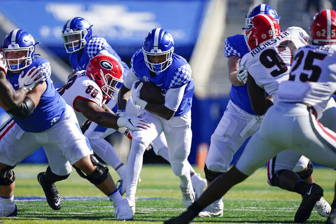 Kentucky running back Asim Rose Jr. (10) runs with the ball during the first half of an NCAA college football game against Georgia, Oct. 31, 2020, in Lexington, Ky. (AP Photo/Bryan Woolston)