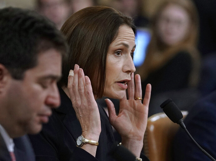 Former White House national security aide Fiona Hill, and David Holmes, right, a U.S. diplomat in Ukraine, testify before the House Intelligence Committee on Capitol Hill in Washington, Thursday, Nov. 21, 2019, during a public impeachment hearing of President Donald Trump's efforts to tie U.S. aid for Ukraine to investigations of his political opponents. (AP Photo/J. Scott Applewhite)