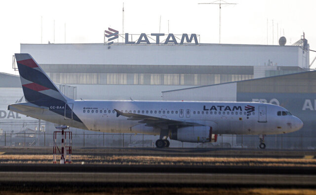 A Latam airplane sits parked at the Arturo Merino Benitez airport in Santiago, Chile, Tuesday, May 26, 2020. South America's biggest carrier is seeking U.S. bankruptcy protection as it grapples with a sharp downturn in air travel sparked by the coronavirus pandemic. (AP Photo/Esteban Felix)