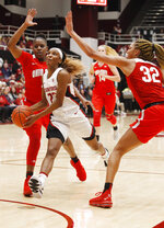 Stanford's Kiana Williams, center, drives for the basket between Ohio State's Janai Crooms, left, and Aaliyah Patty (32) during the first half of an NCAA college basketball game Sunday, Dec. 15, 2019, in Stanford, Calif. (AP Photo/George Nikitin)