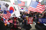 South Korean protesters stage a rally to denounce policies of South Korean President Moon Jae-in on North Korea in Seoul, South Korea, Friday, March 1, 2019. Moon said Friday his government plans to discuss with the United States the possibility of restarting joint inter-Korean economic projects to induce nuclear disarmament from North Korea. (AP Photo/Ahn Young-joon)
