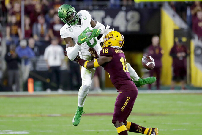 Oregon wide receiver Juwan Johnson (6) can't hold on to a pass as Arizona State defensive back Connor Soelle (18) defends during the first half of an NCAA college football game Saturday, Nov. 23, 2019, in Tempe, Ariz. (AP Photo/Matt York)