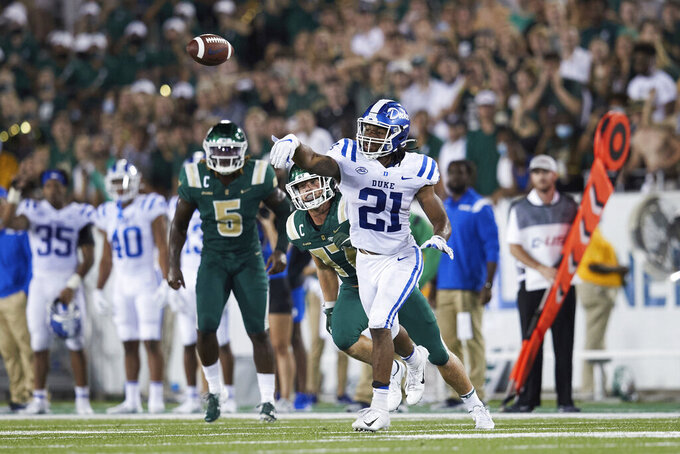Duke running back Mataeo Durant (21) laterals the ball on the final play against Charlotte during an NCAA college football game on Friday, Sept. 3, 2021, in Charlotte, N.C. (AP Photo/Brian Westerholt)